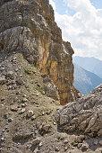 'Alps, Karwendel Mountains, woman hiking in rocky alpine landscape'