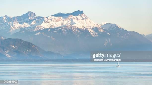alps on lake geneva with a boat at montreux, switzerland - モントルー ストックフォトと画像