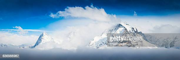 Alps snow capped summits of Eiger and Jungfrau panorama Switzerland