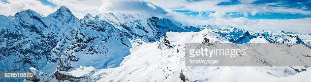 Alps snowy peaks off piste ski runs winter panorama Switzerland
