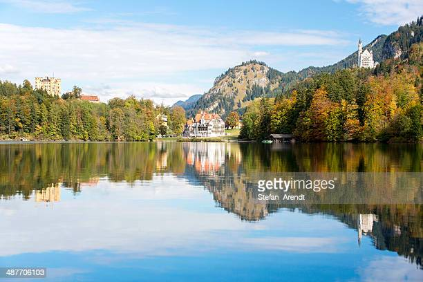 Alpsee lake with the royal castles of Schloss Neuschwanstein and Schloss Hohenschwangau in autumn, Fuessen, East Allgaeu, Bavaria, Germany