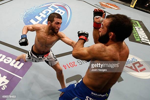 Alptekin Ozkilic punches Darren Uyenoyama in their flyweight bout during the UFC on FOX event at Sleep Train Arena on December 14 2013 in Sacramento...