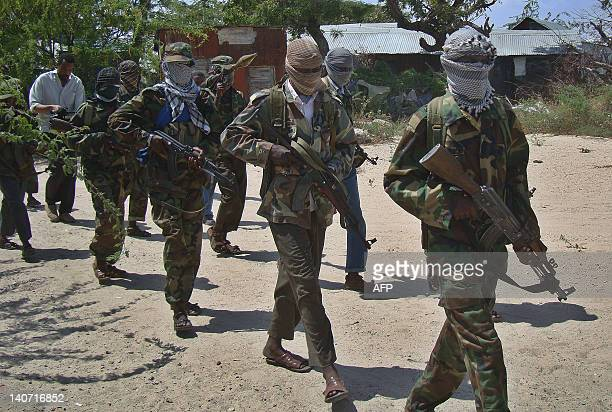 AlQaeda linked alshabab recruits walk down a street on March 5 2012 in the Deniile district of the Somalian capital Mogadishu following their...