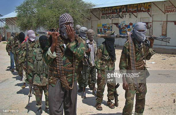 Al-Qaeda linked al-shabab recruits walk down a street on March 5, 2012 in the Deniile district of Somalian capital, Mogadishu, following their...