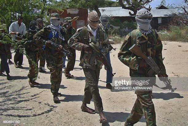 AlQaeda linked alshabab recruits walk down a street on March 5 2012 in the Deniile district of the Somalian capital Mogadishu following their...