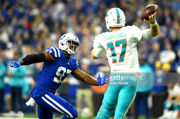 AlQuadin Muhammad of the Indianapolis Colts chase down Ryan Tannehill of the Miami Dolphins in the first quarter at Lucas Oil Stadium on November 25...
