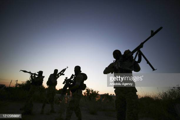 AlQuds Brigades the armed wing of Islamic Jihad Movement keep guard at the border between Gaza and Israel amid coronavirus on Muslim's holy month of...