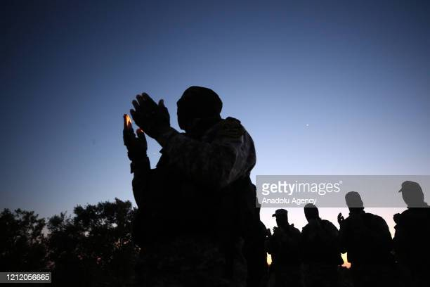 AlQuds Brigades the armed wing of Islamic Jihad Movement perform prayer as they keep guard at the border between Gaza and Israel amid coronavirus on...