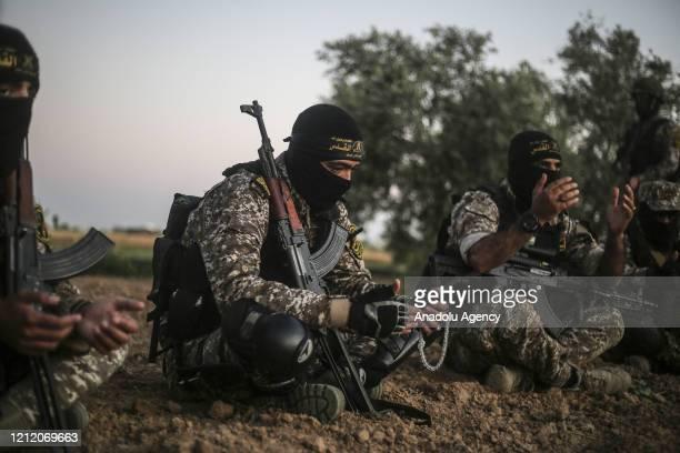 AlQuds Brigades the armed wing of Islamic Jihad Movement pray as they keep guard at the border between Gaza and Israel amid coronavirus on Muslim's...