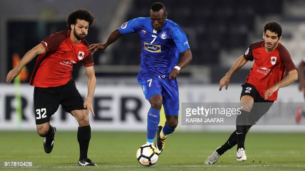 AlRayyan SC's QatariEgyptian midfielder Ahmed Abdul Maqsoud and his Qatari teammate and defender Mohammed Alaaeldin vie for the ball against...