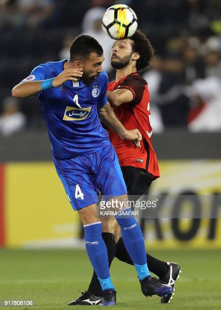 AlRayyan SC's QatariEgyptian midfielder Ahmed Abdul Maqsoud vies for the ball against Esteghlal FC's Iranian defender Rouzbeh Cheshmi during their...