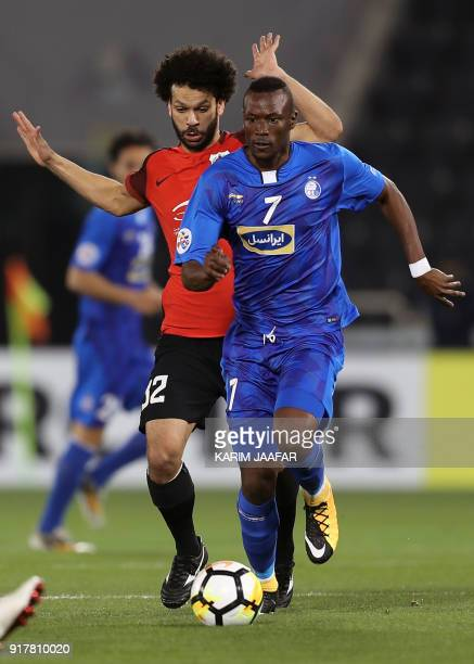 AlRayyan SC's QatariEgyptian midfielder Ahmed Abdul Maqsoud vies for the ball against Esteghlal FC's Senegalese forward Mame Baba Thiam during their...
