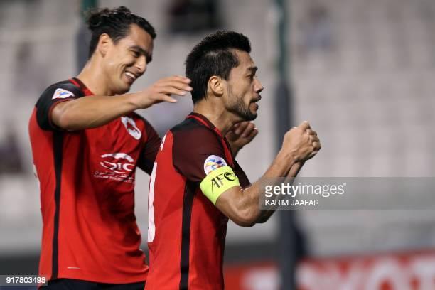 AlRayyan SC's QatariUruguayan forward Sebastian Soria congratulates his QatariBrazilian midfielder and captain Rodrigo Tabata after the latter scored...