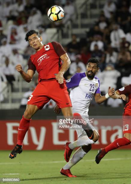 AlRayyan SC's Uruguayanborn Qatari forward Sebastian Soria leaps for the ball as he vies against AlAin FC's Emirati defender Mohamed Ahmed during...