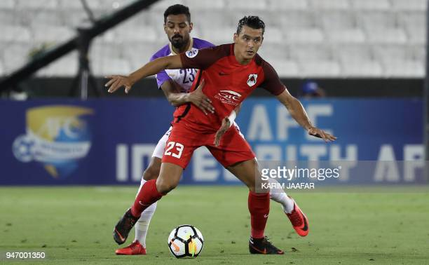 AlRayyan SC's Uruguayanborn Qatari forward Sebastian Soria vies for the ball against AlAin FC's Emirati defender Mohamed Ahmed during their Asian...