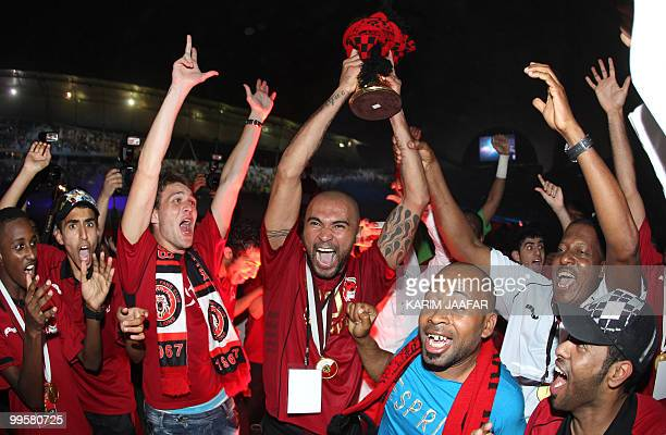 AlRayyan's Brazilian player Afonso Alves celebrates after beating Umm Salal 10 in the Qatari's clubs' Emir Cup final football match in Doha on May 15...