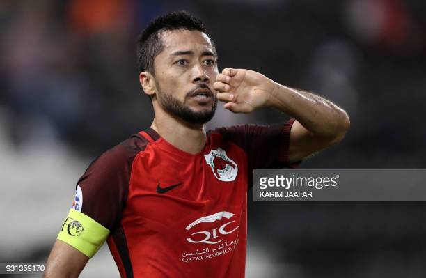 AlRayyan's captain and midfielder Rodrigo Tabata gestures in celebration of his goal during the AFC Asian Champions League group D football match on...