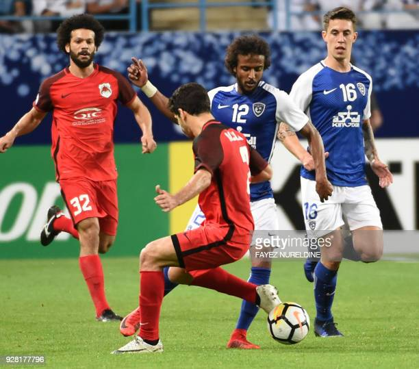 AlRayyan's Mohammed Alaaeldin views for the ball against alHilal's Yasir Shahrani during the AFC Champions League football match between Saudi...