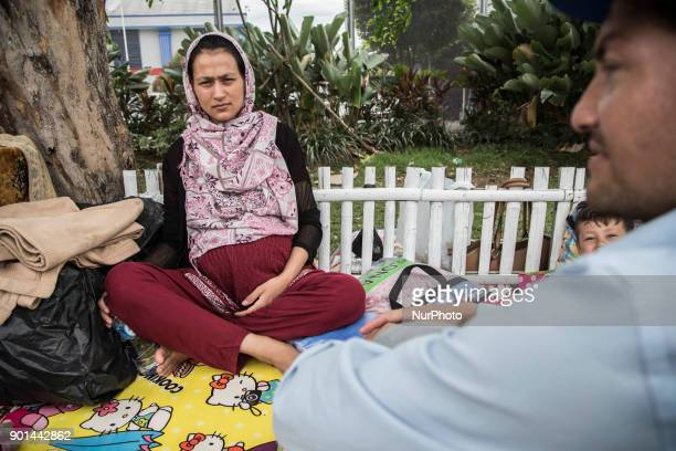 TAYEBA already nine month pregnant waiting to get inside the immigration detention at Jakarta Dozens of refugee from Afghanistan Sudan and Somalia...