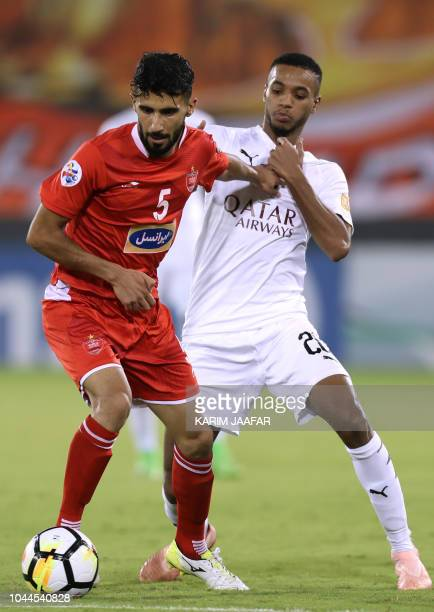 AlSadd SC's Salem Al Hajri vies for the ball against Persepolis FC's Bashar Resan during the AFC Champions League semifinal first leg match between...