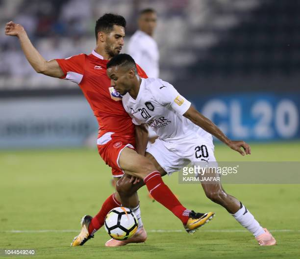 AlSadd SC's Salem Al Hajri vies for the ball against Persepolis FC's Omid Alishah during the AFC Champions League semifinal first leg match between...
