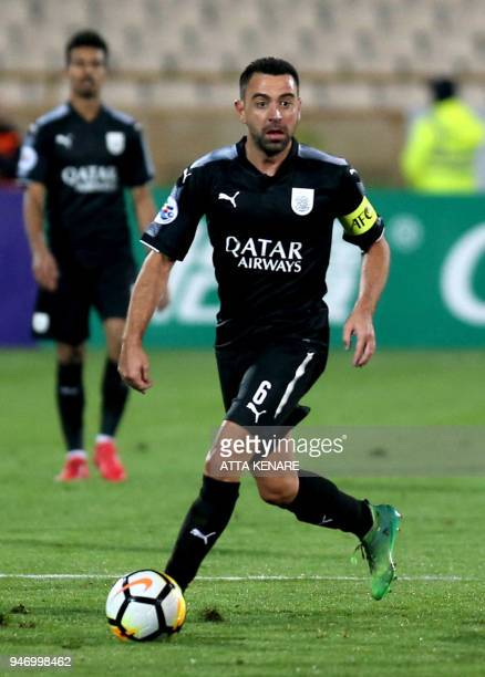 AlSadd's Xavi Hernandez dribbles the ball during the AFC Champions League match between alSadd and Persepolis at the Azadi Stadium in Tehran on April...
