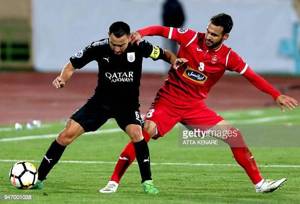 AlSadd's Xavier Hernandez and Persepolis' Ahmad Noorollahi defends during the AFC Champions League match between alSadd and Persepolis at the Azadi...