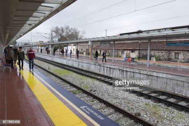alsancak subway station platform with waiting passengers,izmir. - emreturanphoto stock pictures, royalty-free photos & images