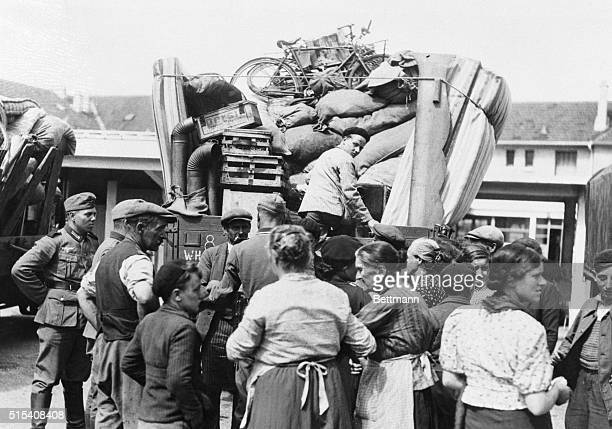 Alsatian refugees returning to the homes and farms they vacated when the Germans invaded France shown at a Nazi refugee center in AlsaceLorraine as...