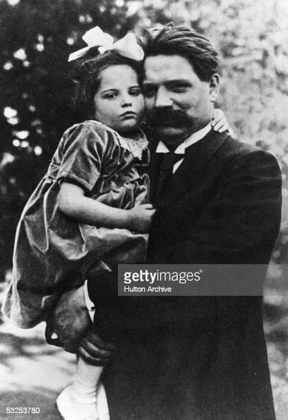 Alsatianborn German theologian musician physician and medical missionary Albert Schweitzer holds his daughter Rhena Schweitzer 1923