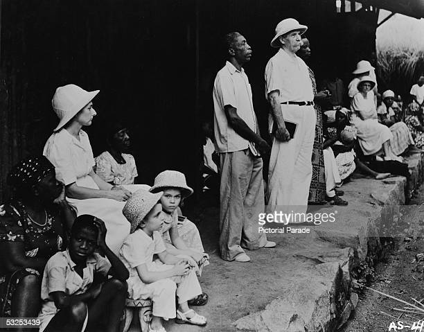 Alsatian-born German theologian, physician, and medical missionary Albert Schweitzer conducts a Sunday worship service with two interpreters at the...