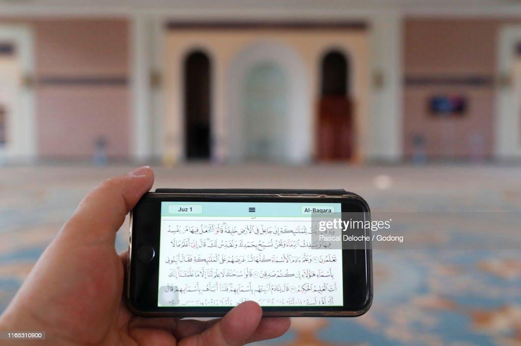 Alserkal Mosque Man Reading An Electronic Quran On A