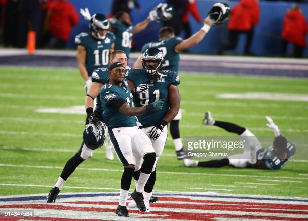 Alshon Jeffery and Fletcher Cox of the Philadelphia Eagles celebrate defeating the New England Patriots 4133 in Super Bowl LII at US Bank Stadium on...