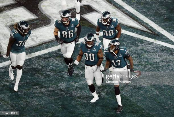 Alshon Jeffery and teammates of the Philadelphia Eagles celebrate a 34yard touchdown pass against the New England Patriots in the first quarter of...
