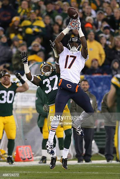 Alshon Jeffery of the Chicago Bears can't catch the football in front of Sam Shields of the Green Bay Packers in the first quarter at Lambeau Field...