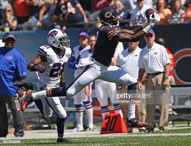 Alshon Jeffery of the Chicago Bears catches a pass in front of Leodis McKelvin of the Buffalo Bills during the first quarter of their game at Soldier...