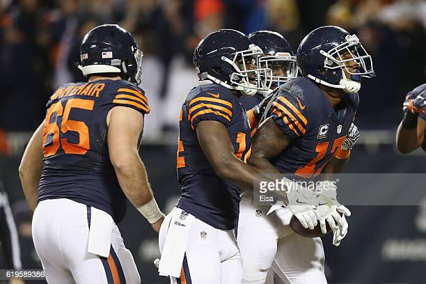 Alshon Jeffery of the Chicago Bears celebrates with teammates after scoring a touchdown during the third quarter against the Minnesota Vikings at...