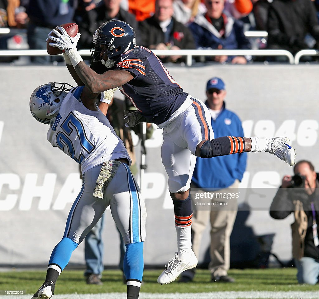 Alshon Jeffery #17 of the Chicago Bears makes an apparent touchdown catch over Glover Quin #27 of the Detroit Lions but referees ruled Jeffery did not have control of the ball when he came down in the end zone at Soldier Field on November 10, 2013 in Chicago, Illinois.