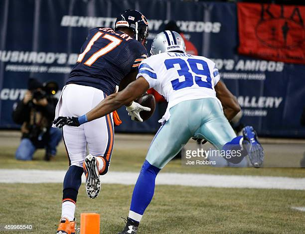 Alshon Jeffery of the Chicago Bears scores a touchdown past Brandon Carr of the Dallas Cowboys during the fourth quarter of a game at Soldier Field...