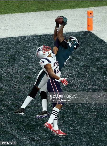 Alshon Jeffery of the Philadelphia Eagles catches a 34yard touchdown pass against Eric Rowe of the New England Patriots in the first quarter of Super...