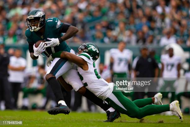 Alshon Jeffery of the Philadelphia Eagles catches a pass and is tackled by Trumaine Johnson of the New York Jets in the second half at Lincoln...