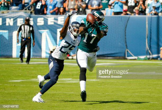 Alshon Jeffery of the Philadelphia Eagles catches a pass from Carson Wentz while defended by Adoree' Jackson of the Tennessee Titans during the...
