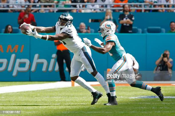 Alshon Jeffery of the Philadelphia Eagles catches the ball while being defended by Ken Webster the Miami Dolphins during an NFL game on December 1...