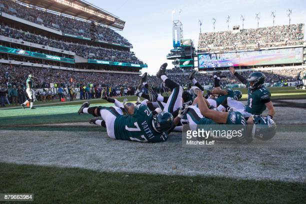 Alshon Jeffery of the Philadelphia Eagles celebrates scoring his touchdown with Halapoulivaati Vaitai Mack Hollins and Carson Wentz in the second...
