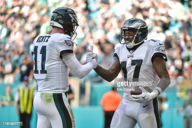 Alshon Jeffery of the Philadelphia Eagles celebrates with Carson Wentz after scxoring a touchdown in the third quarter against the Miami Dolphins at...