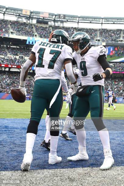 Alshon Jeffery of the Philadelphia Eagles celebrates with Nick Foles after scoring a 3 yard touchdown against the New York Giants during the first...