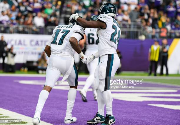Alshon Jeffery of the Philadelphia Eagles celebrates with teammate Jordan Howard after scoring a touchdown in the third quarter of the game agains...