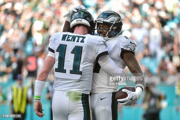 Alshon Jeffery of the Philadelphia Eagles hugs Carson Wentz after scxoring a touchdown in the third quarter against the Miami Dolphins at Hard Rock...