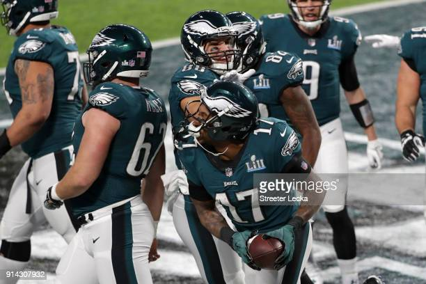 Alshon Jeffery of the Philadelphia Eagles is congratulated by his teammates after scoring a 34yard touchdown reception during the first quarter...