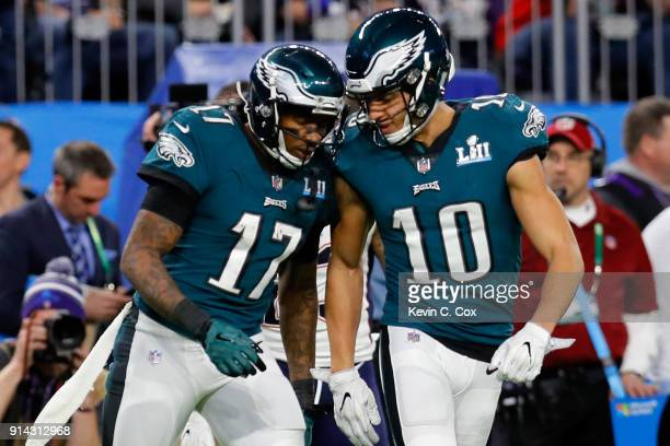 Alshon Jeffery of the Philadelphia Eagles is congratulated by his teammate Mack Hollins after his 21yard reception against the New England Patriots...